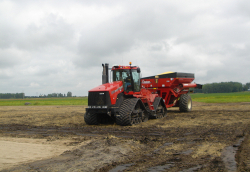 Soil compaction caused by heavy machinery under wet field conditions